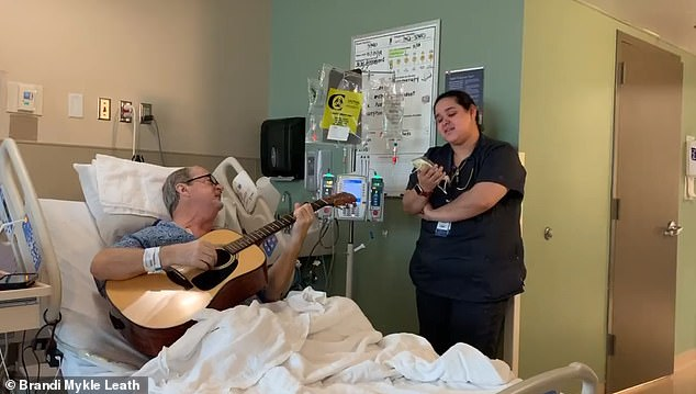Heartwarming moment Tennessee chemotherapy patient and nurse sing duet of O Holy Night